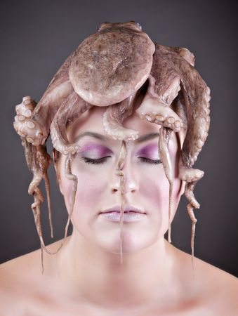 bare shoulders: Young Caucasian woman with bare shoulders wearing an octopus on her head