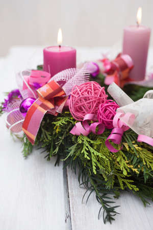 Pink advent wreath Christmas decoration with spruce and pink candles photo