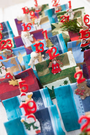 Advent calendar Christmas decoration made of little paper bags photo