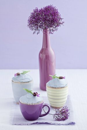 Three Lavender Cupcakes With A Sea Lavender Flower In A Vase Stock