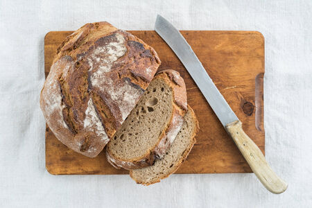 Rustic sourdough bread and knife