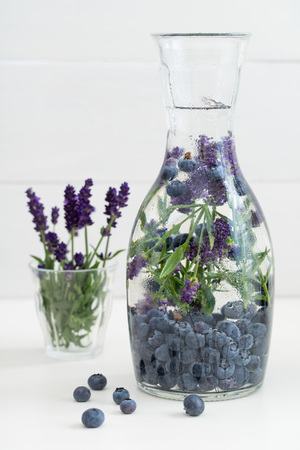 Infused water with blueberries and lavender in a pitcher