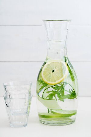 Infused water with cucumber, lemons and mint in a pitcher Zdjęcie Seryjne