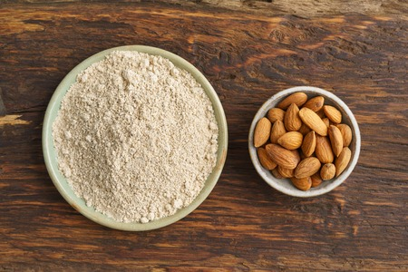 Almond seeds and almond flour in small bowls