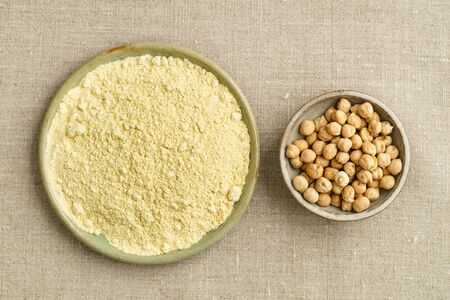 Chickpea seeds and chickpea flour in small bowls Stock Photo