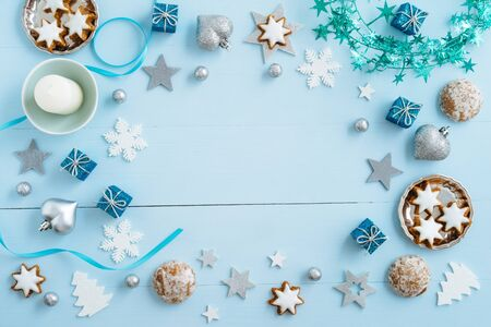Christmas background, mockup, postcard or website header design with copyspace in the centre on blue wooden table