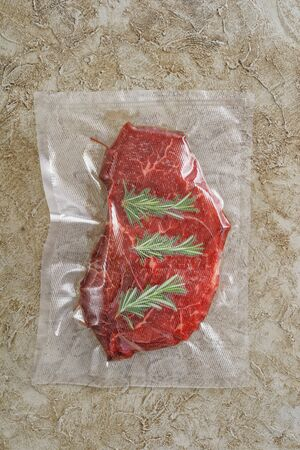 Roast beef sealed in an airtight plastic bag ready for sous vide cooking Zdjęcie Seryjne
