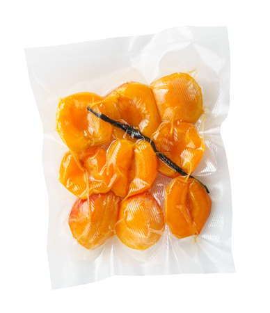 Vacuum sealed fresh apricots with vanilla for sous vide cooking cutout on white Zdjęcie Seryjne