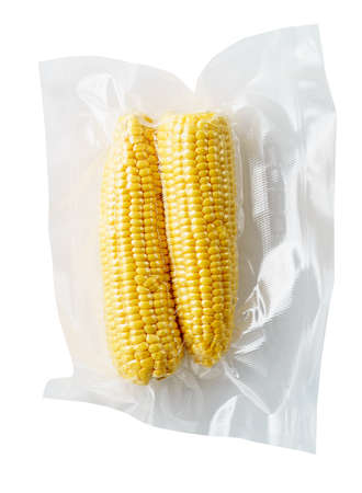 Vacuum sealed fresh corncobs for sous vide cooking cutout on white Stok Fotoğraf