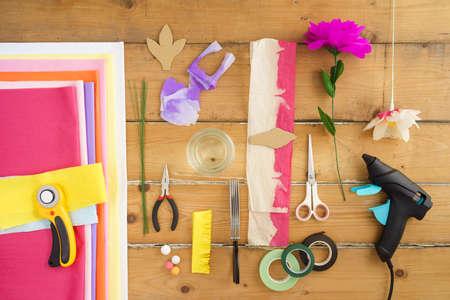 Utensils for making paper flowers on wooden table Zdjęcie Seryjne