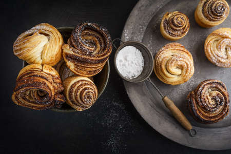 Fresh baked cruffins trend pastry on rustic platter Stock Photo