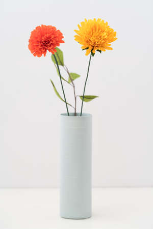 Bouquet Of Crepe Paper Marigold Flowers In A Vase On White Stock