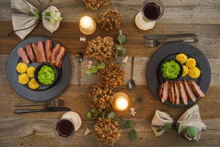 Christmas menu with duck breast, mushy peas, duchess potatoes and wine