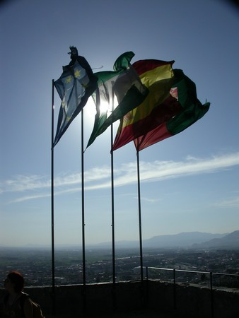 Backlit flags over the Alhambra in Granada, Spain