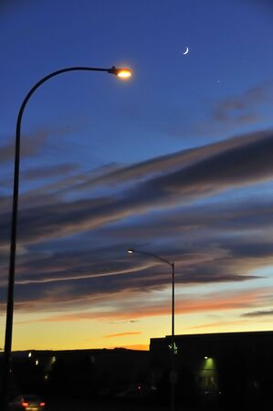 in conjunction: Streetlights with Moon, Venus and Jupiter Conjunction Stock Photo
