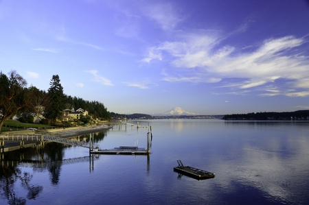 hale: Swimming float on Hale Passage between Gig Harbor and Fox Island Washington with Mount Rainier in alpenglow in the background. Stock Photo