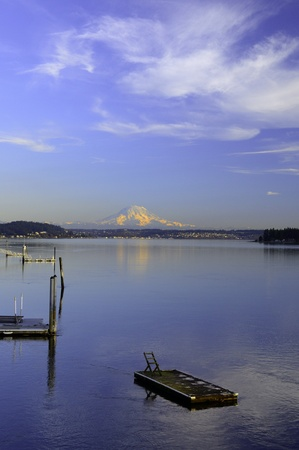 gig harbor: Swimming float on Hale Passage between Gig Harbor and Fox Island Washington with Mount Rainier in alpenglow in the background. Stock Photo