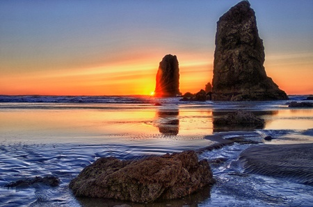 Golden sunset over the Pacific Ocean with rock and seastacks near Beacon Rock ta Cannon Beach, Oregon  photo