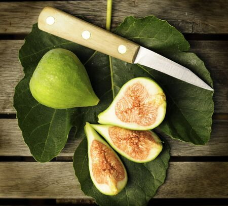 Fig leaf with figs and knife.