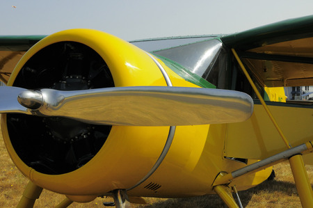 chrome: Yellow airplane with chrome propeller