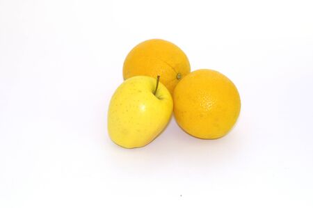 Two oranges and one apple on white background 免版税图像