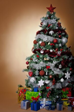 isolated chirstmas tree with silver and red decoration photo