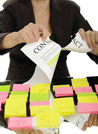 broken contract: business woman hands holding sticky notes; business concepts
