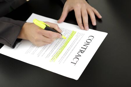 business woman signing contract; business concepts and ideas photo