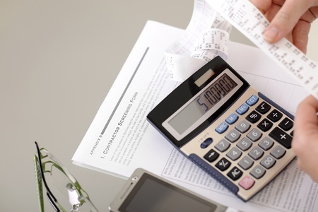 secretary at office calculating bills;business concepts photo