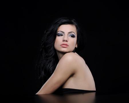fashion woman on black background posing Stock Photo - 11639773