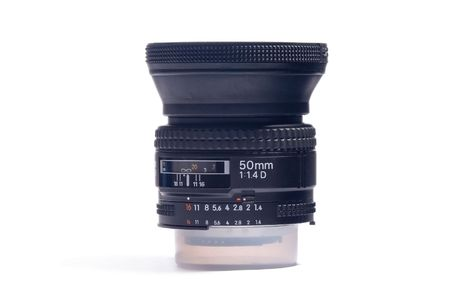 Black camera lens in white background Stock Photo - 7042947