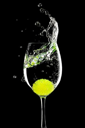 splash in a glass with lemon ball on a black background Stock Photo - 7142121