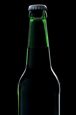 beer bottle close-up over black background photo
