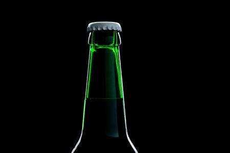 green bottle beer close-up over black background photo