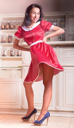 beautiful girl in a red polka-dot dress developing in the café Stock Photo - 9681171