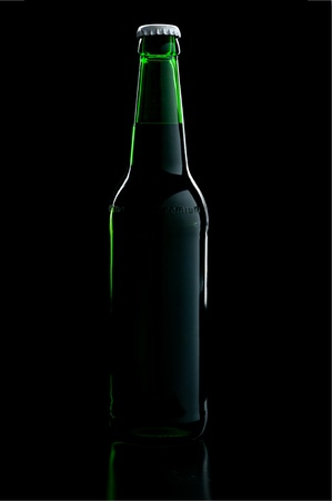 a green bottle beer over black background with shadow photo