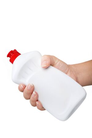 Hand with a detergent  plastic bottle isolated on white background photo