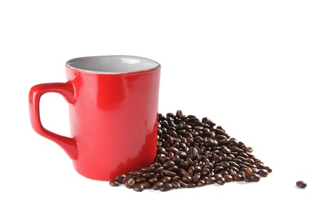 square red ceramic cup and coffee beans over white photo