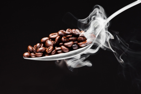 spoon coffee on black background with smoke photo