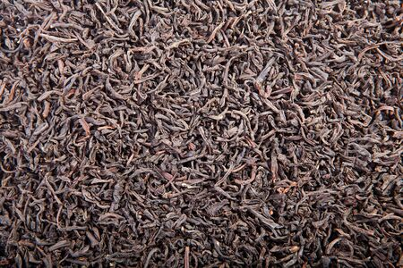 Black tea loose dried tea leaves, isolated on the white background Stock Photo - 15357354