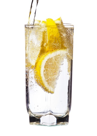 Full glass of water with lemon isolated on white background photo