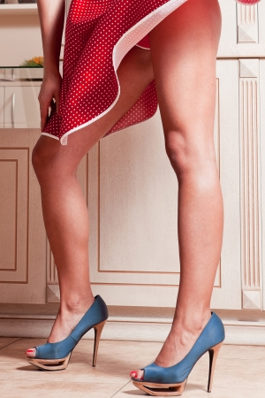 fishnet: Beautiful woman legs in red dress with blue high heel shoes