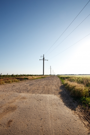 Rural road and the blue sky photo