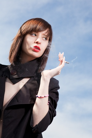 young elegant girl with a cigarette photo