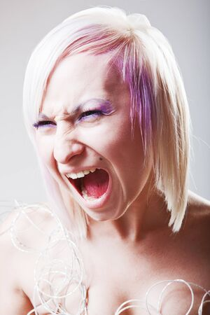 crazy woman: A woman screaming with crazy expression
