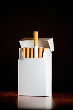Pack of cigarettes isolated on black background,small depth of field photo