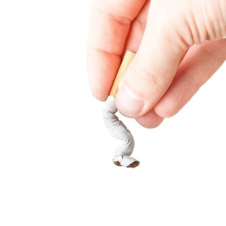 a hand extinguishing a cigarette on white background Stock Photo - 16246945