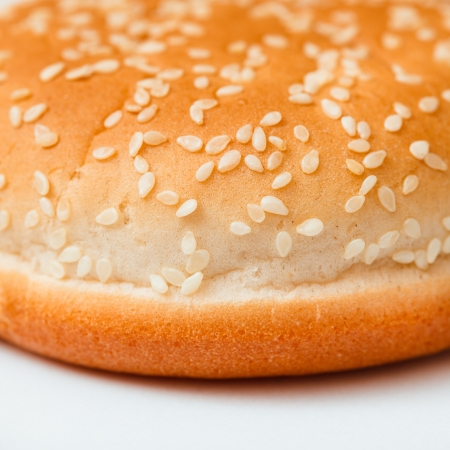 Close-up of burger bun with sesame seeds photo