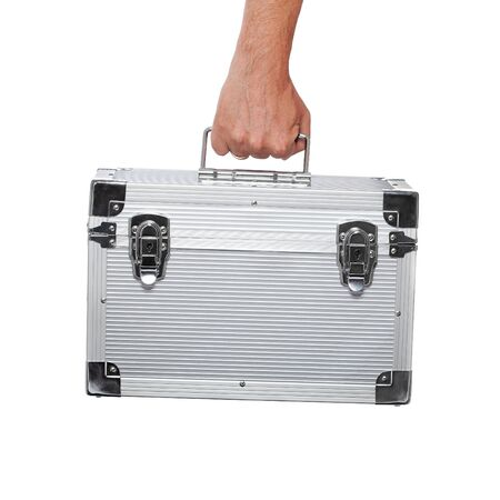 Silver metal briefcase in hand isolated on white photo