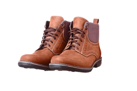 A pair of new brown hiking boots on white background photo